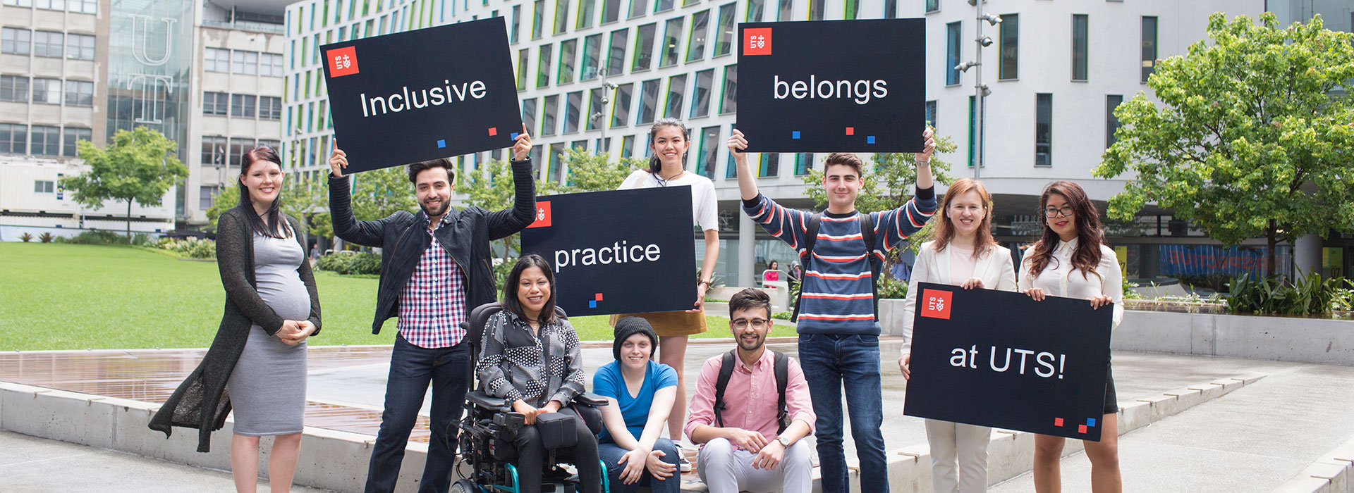 UTS Access Ambassadors holding up signs that say 'Inclusive Practice belongs at UTS'