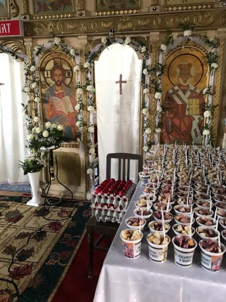 Photo of traditional red-dyed Easter eggs and fruit at the Orthodox Church of St. Nicholas of Sălard.