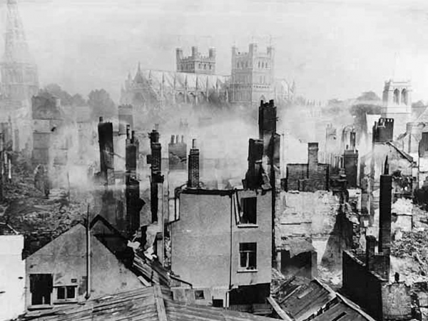 The shattered city of Exeter lies smoking on the morning after, although the cathedral was spared