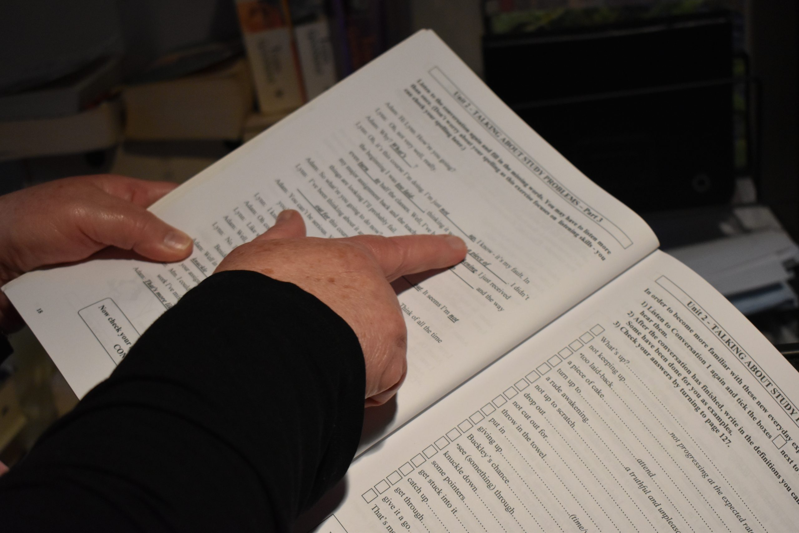 Woman pointing to words on a page
