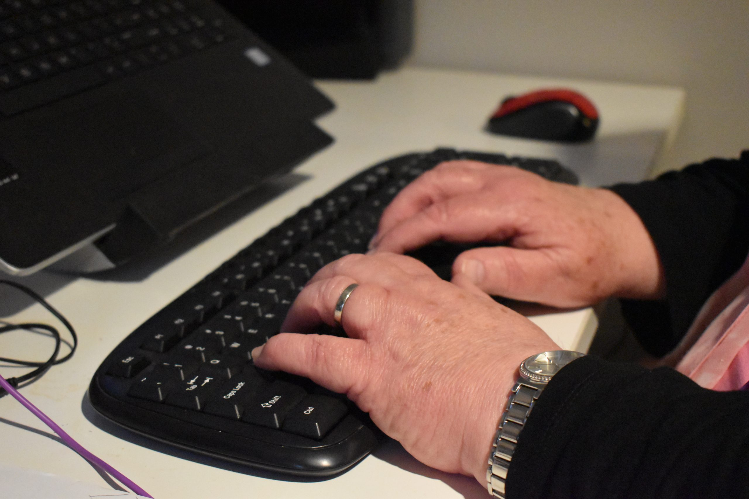 Close up on womans hands on a keyboard