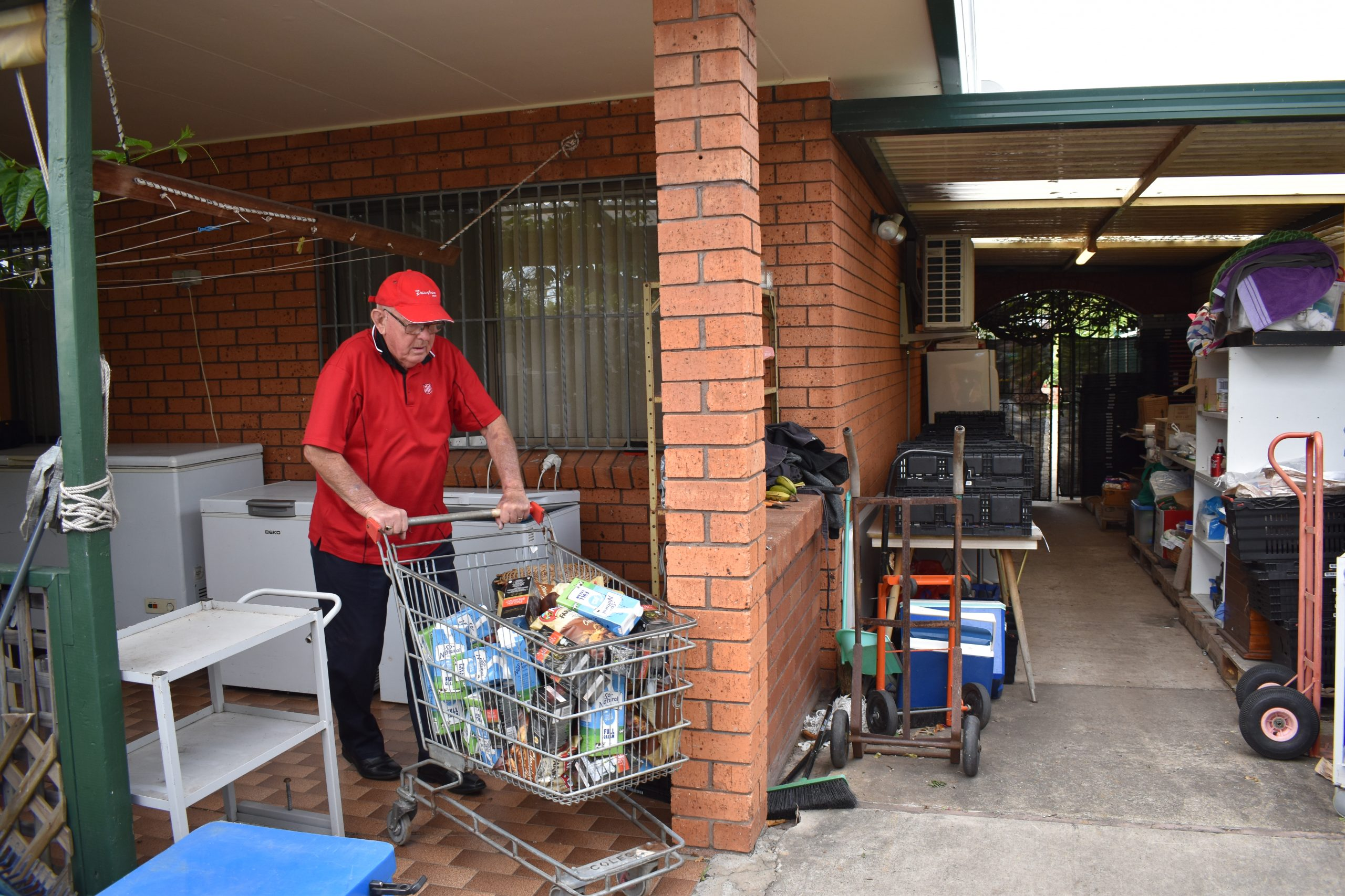 Man with a shopping trolley full of food