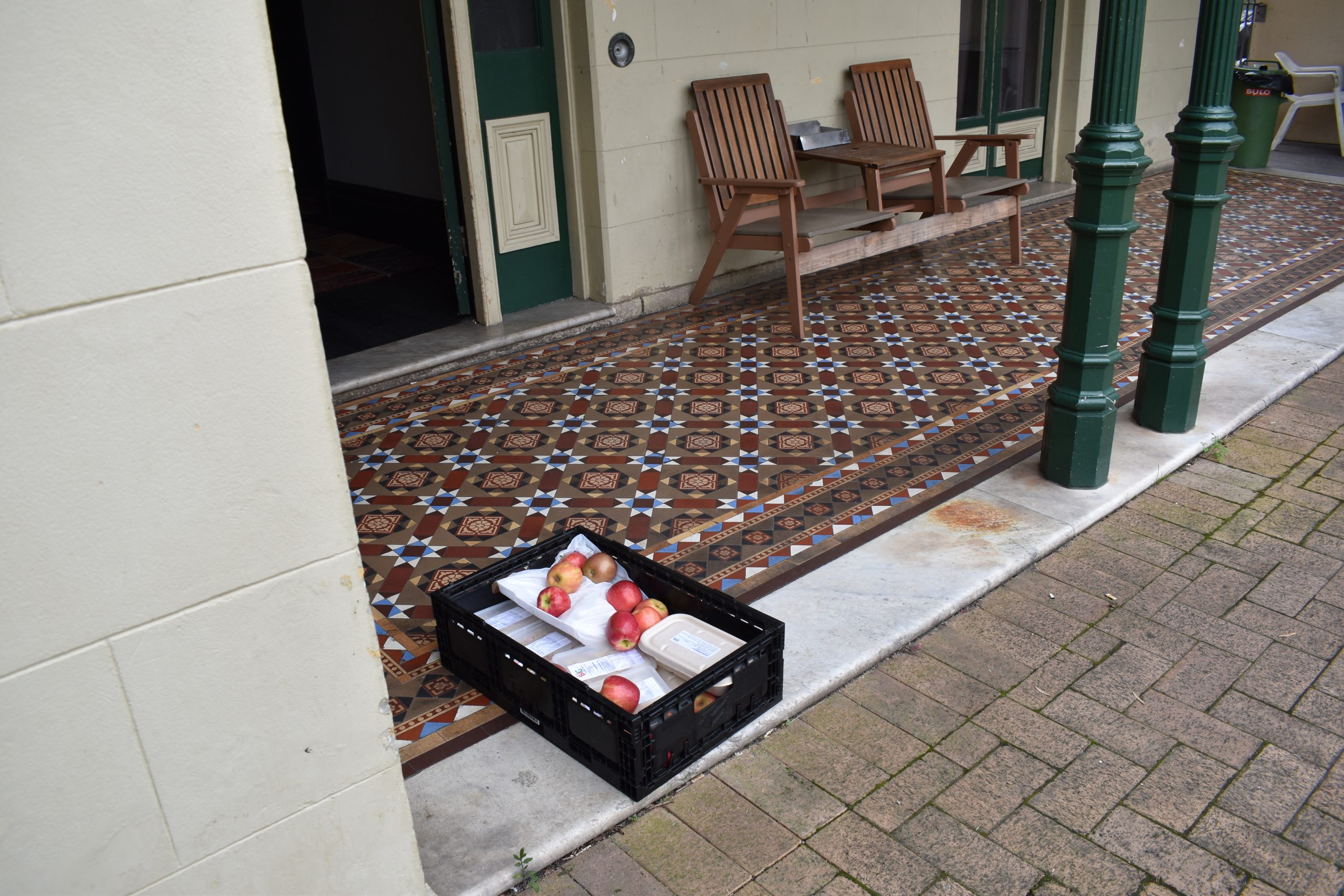 Crate full of food outside a building