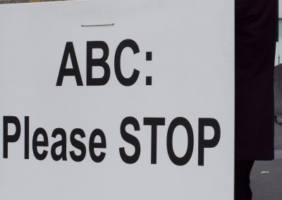 Sign reads, ABC please stop misrepresentation of Falun Gong