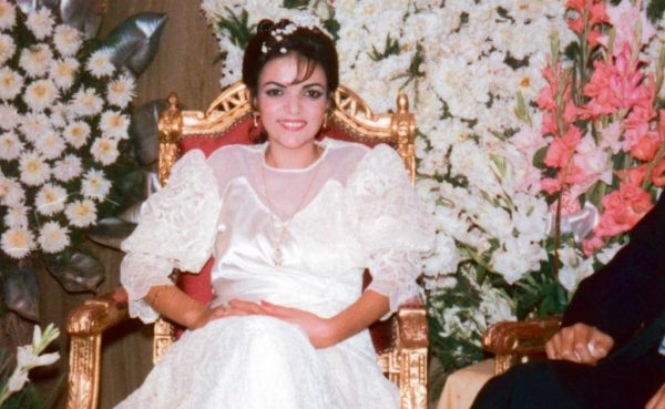 Young Anne Aly in her wedding dress during her first marriage to ex-husband Sherif Rida