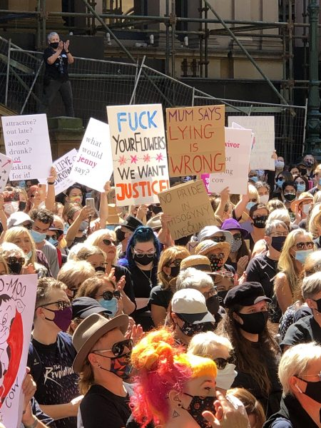 Placards above the crowd at Town Hall. (Photo: Lauren Ivory)