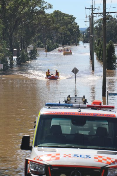 The SES take supplies across flood waters from Governor Phillip Park, Windsor, to the isolated town of Wilberforce last month. (Photo: Flora Cann)