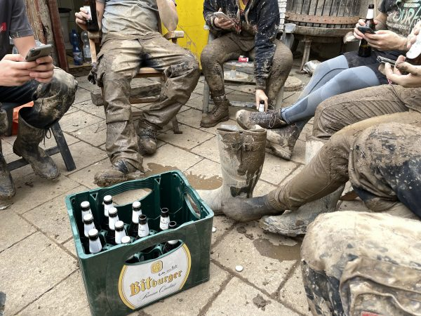 After a day of cleaning up, people gather around for a beer
