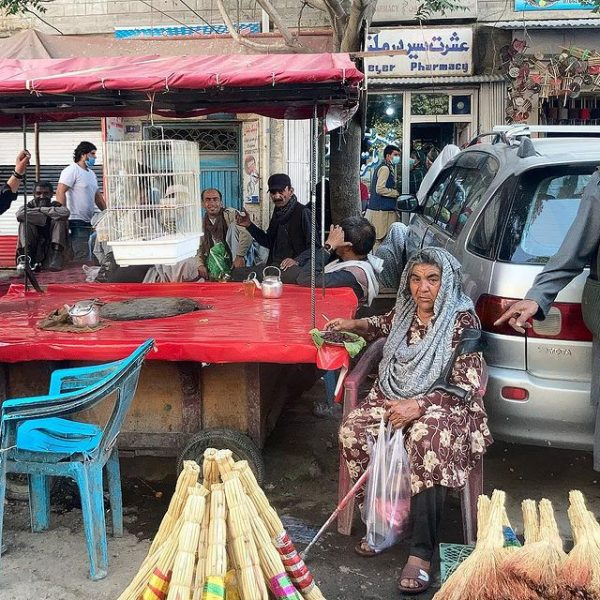 Woman sitting at outdoor market
